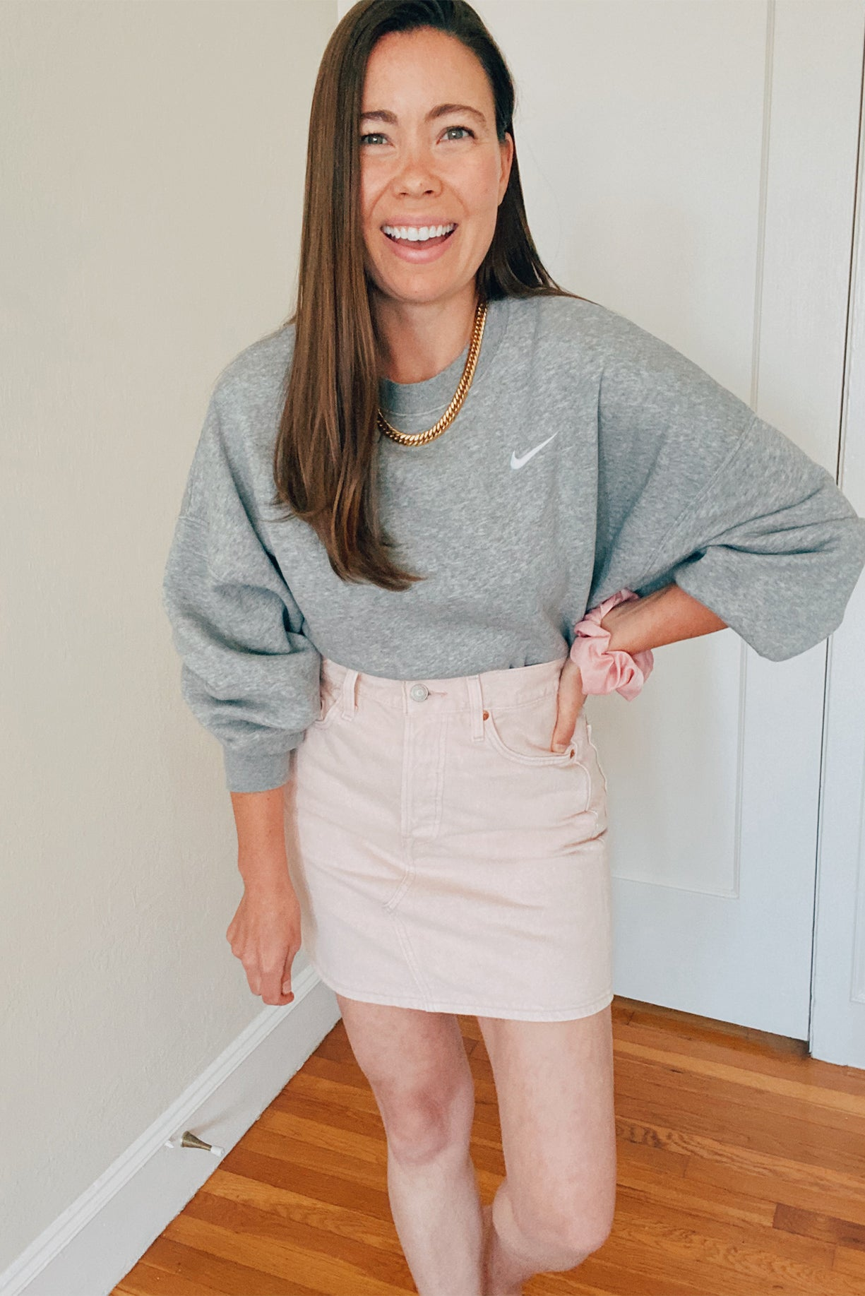 Nike Sweatshirt and Pink Denim Levi's Skirt