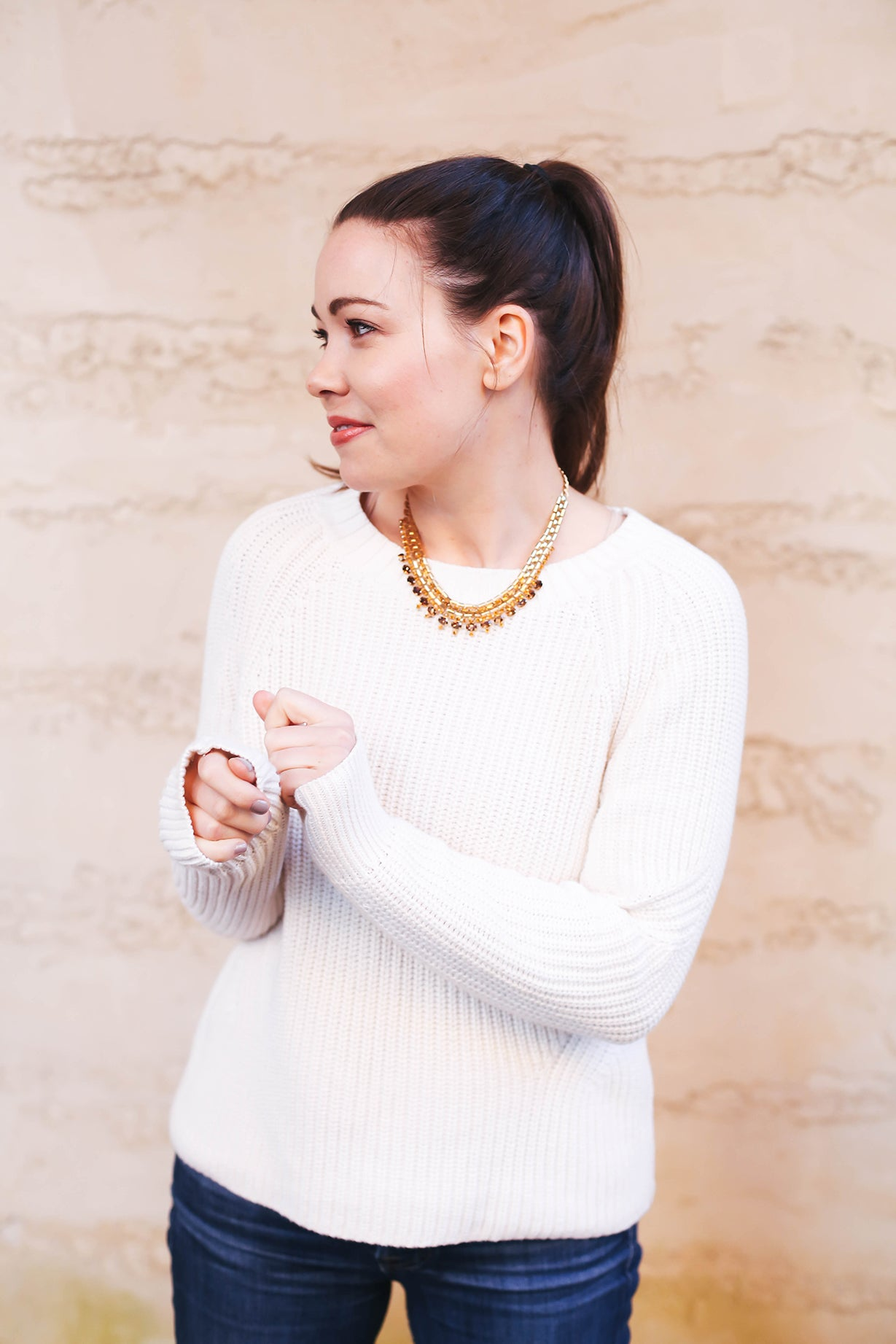 Cream sweater and statement necklace