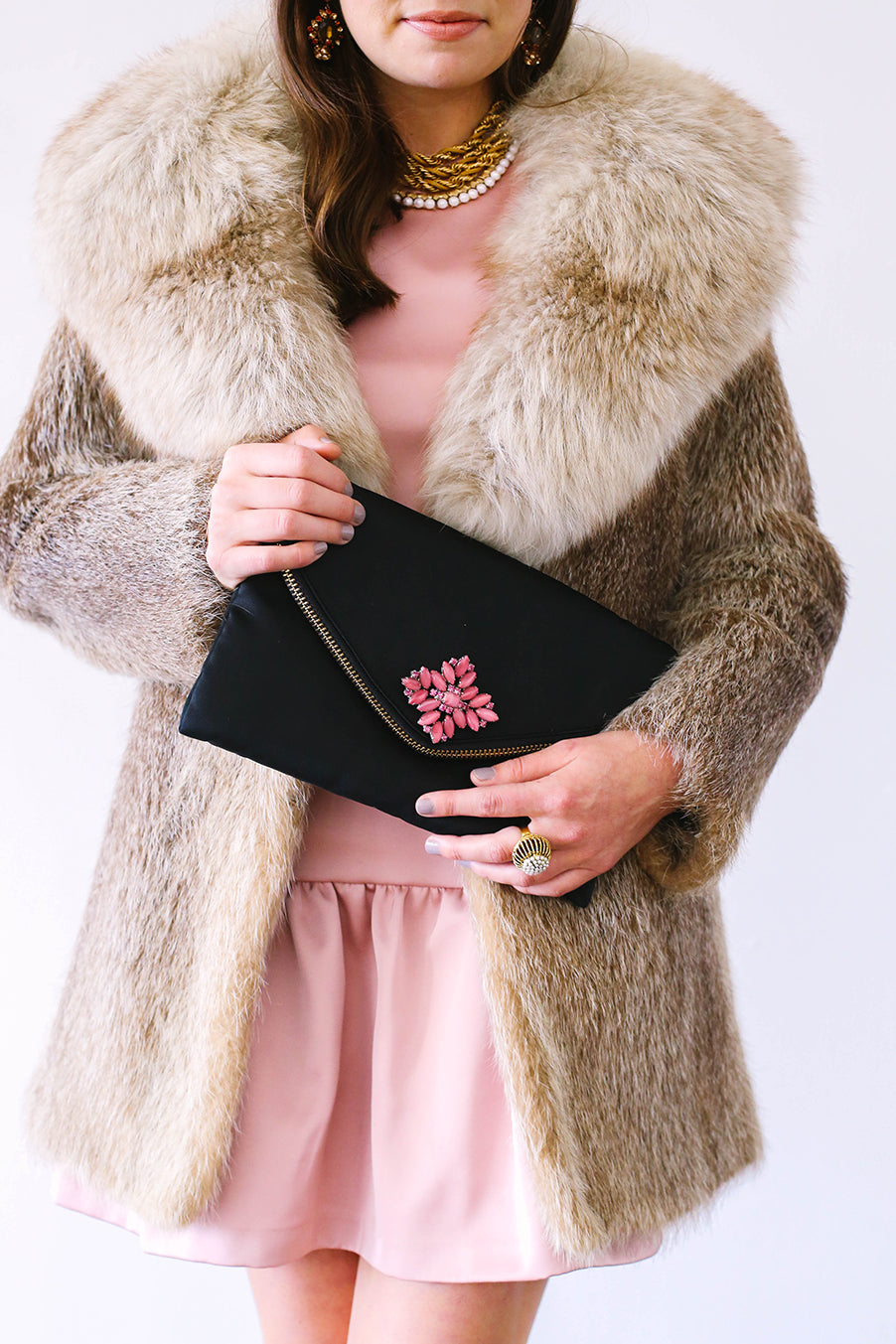 Pink Vintage Brooch on Black Clutch