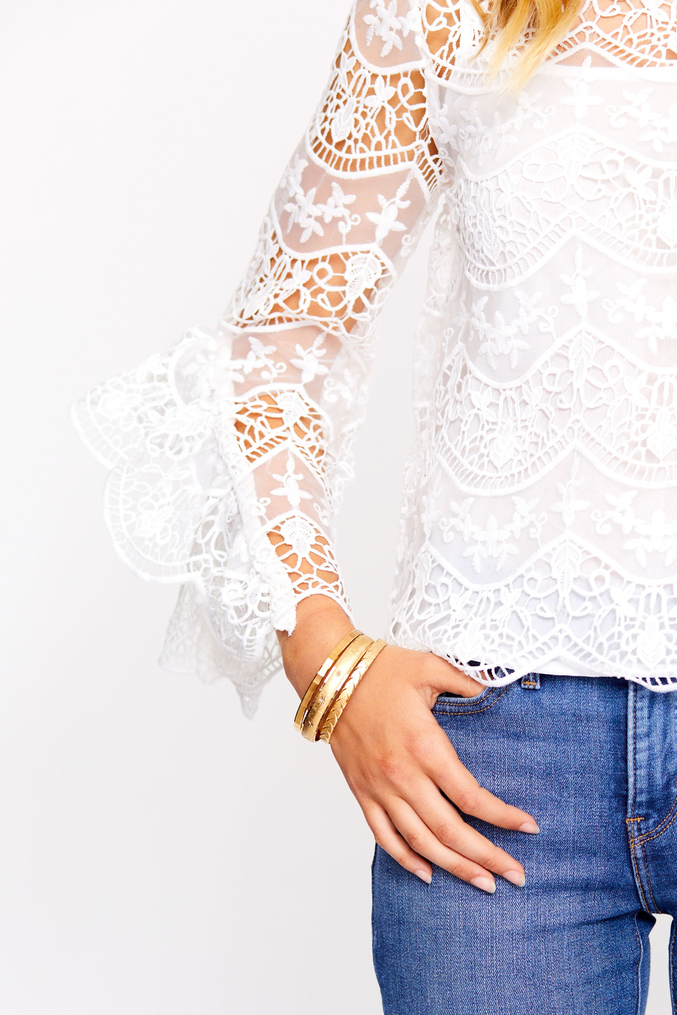 Lace bell sleeve top and gold bangles from Sweet & Spark.