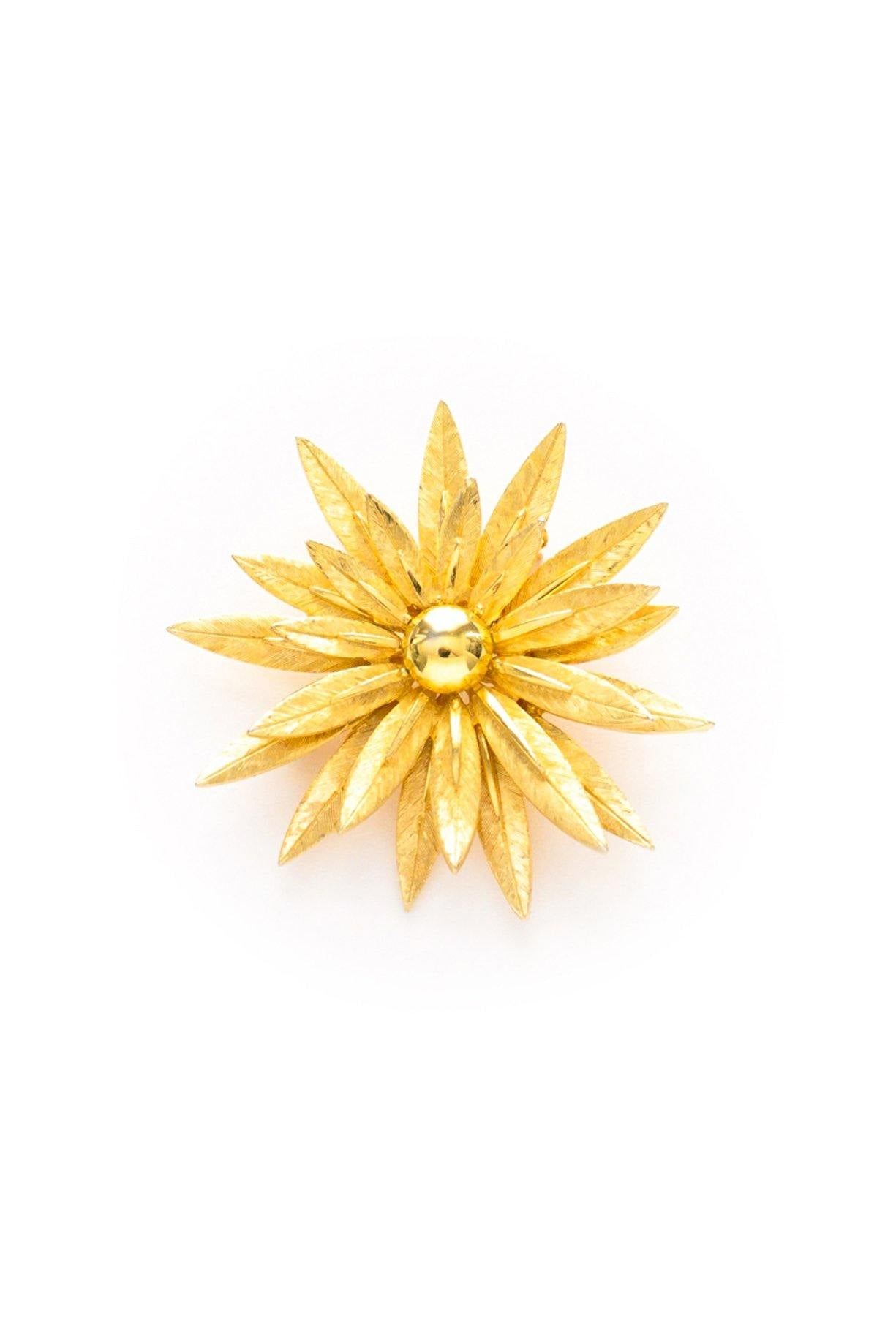 Statement gold burst brooch from Sweet & Spark.