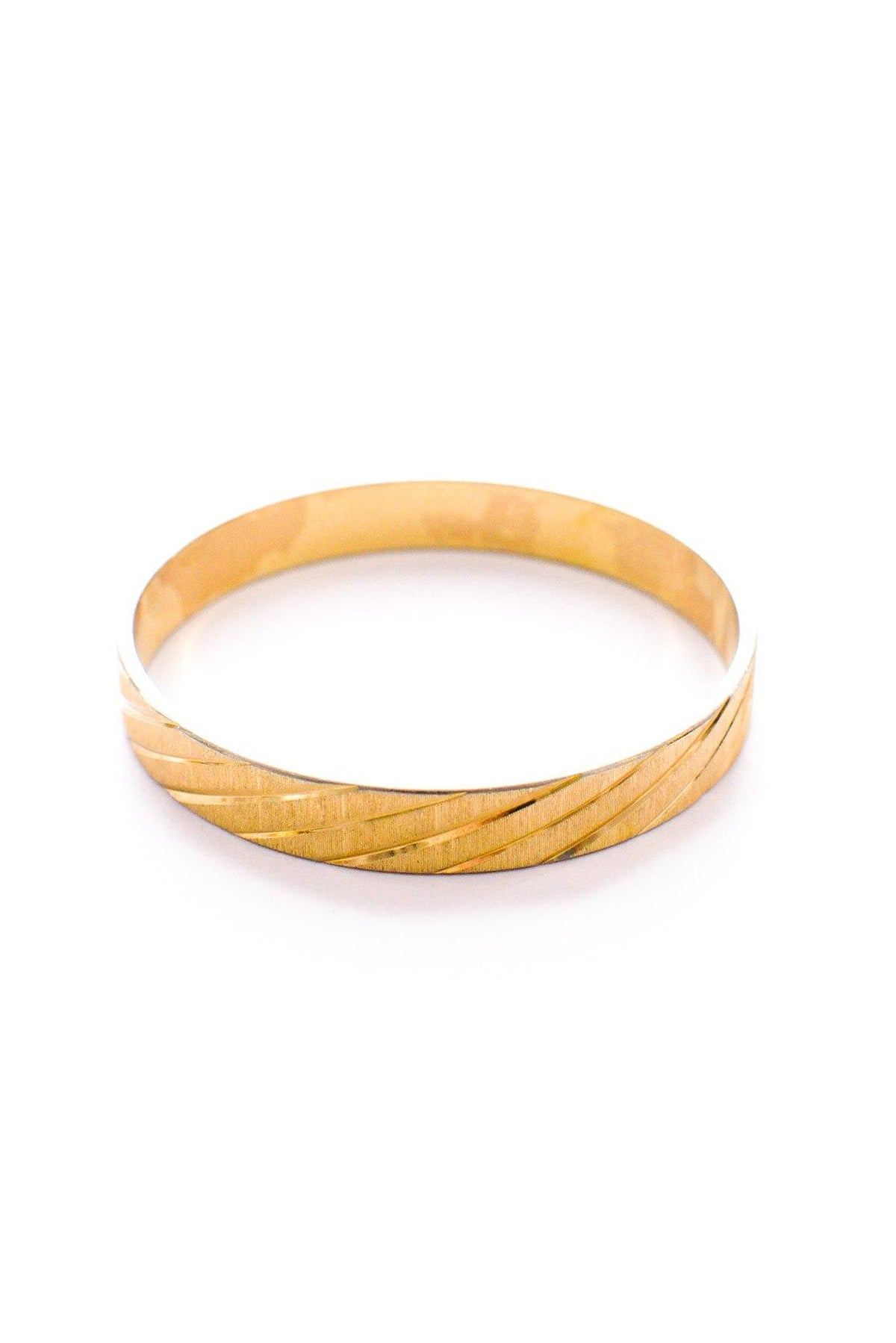Vintage Monet etched gold bangle from Sweet & Spark.