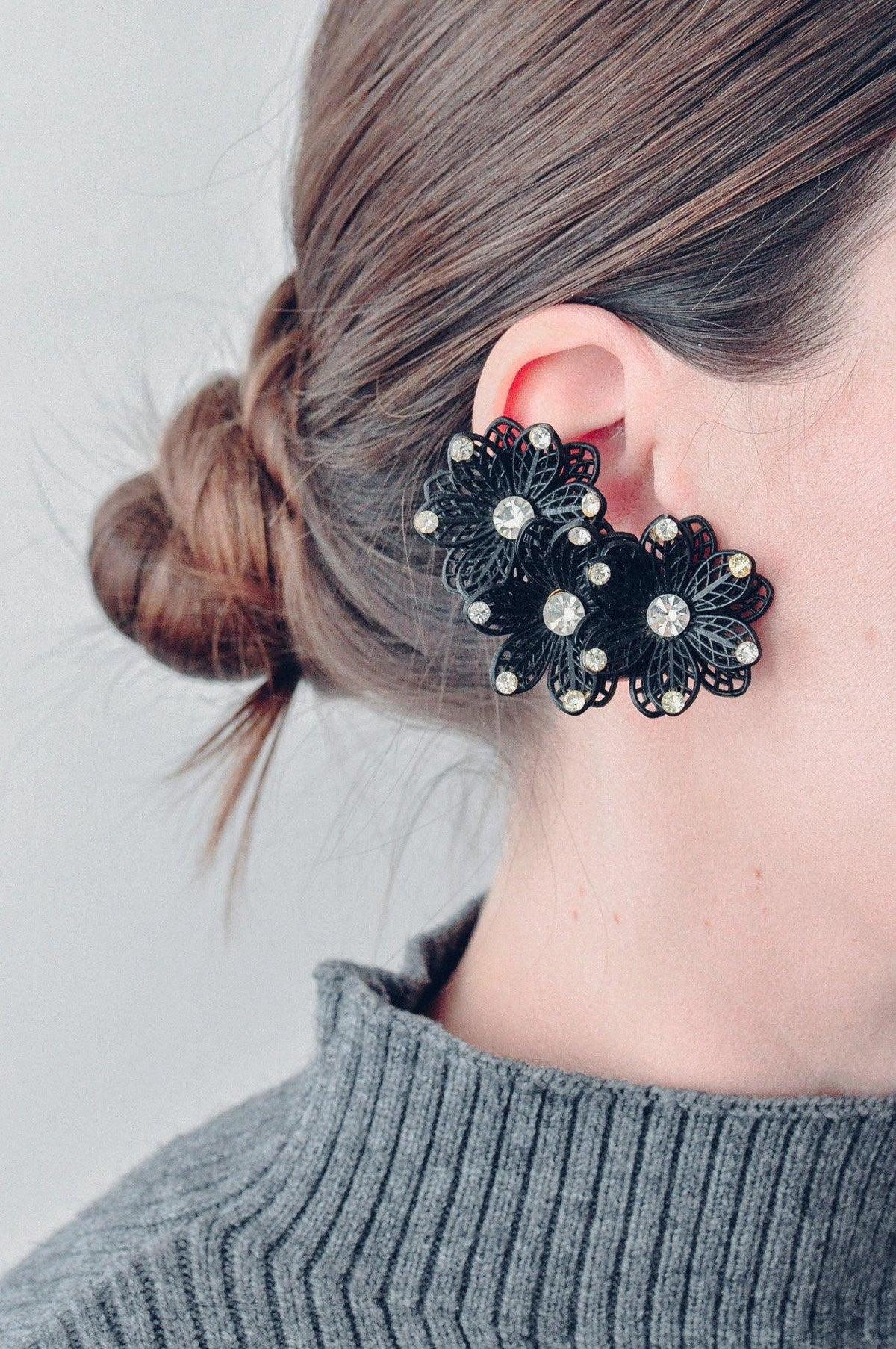 Vintage black floral crawler clip-on earrings from Sweet & Spark.