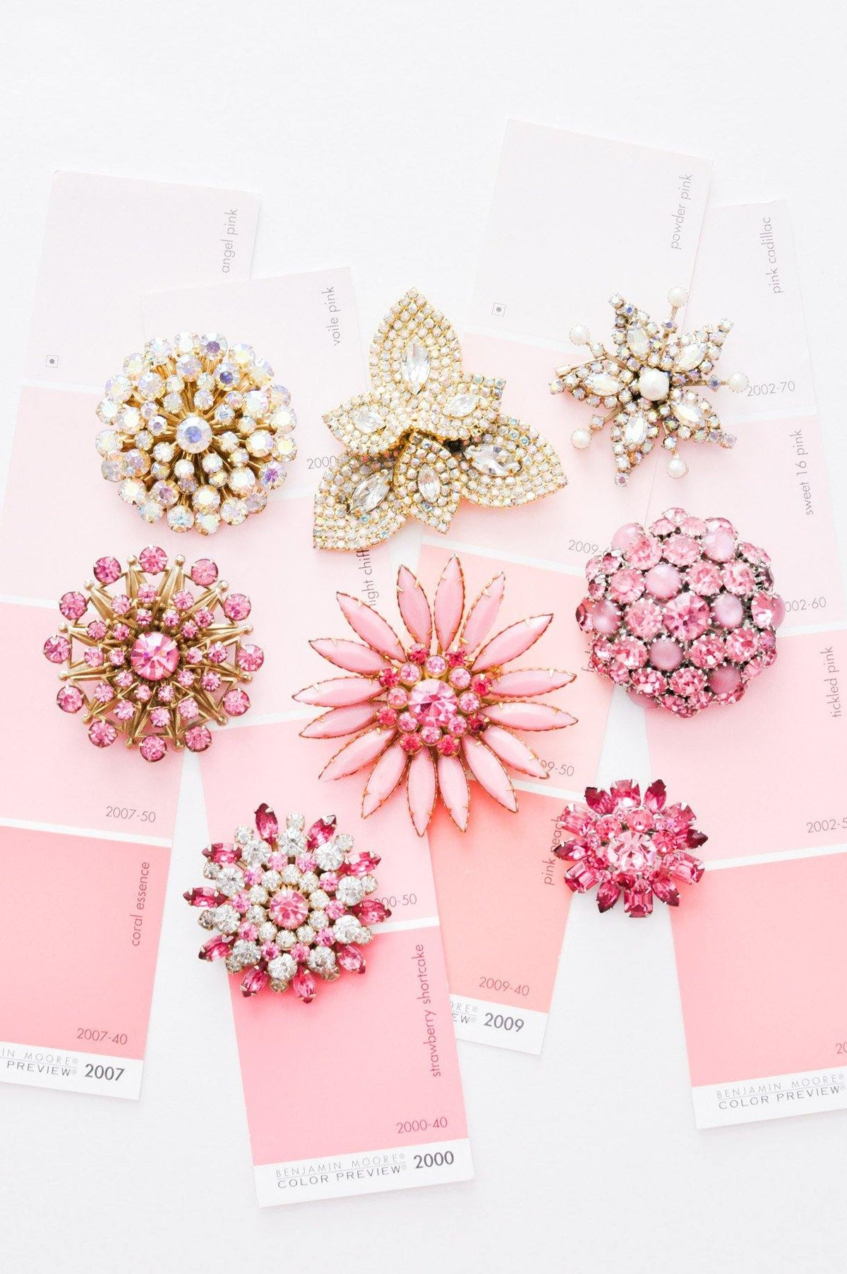 Pink vintage brooches from Sweet & Spark.