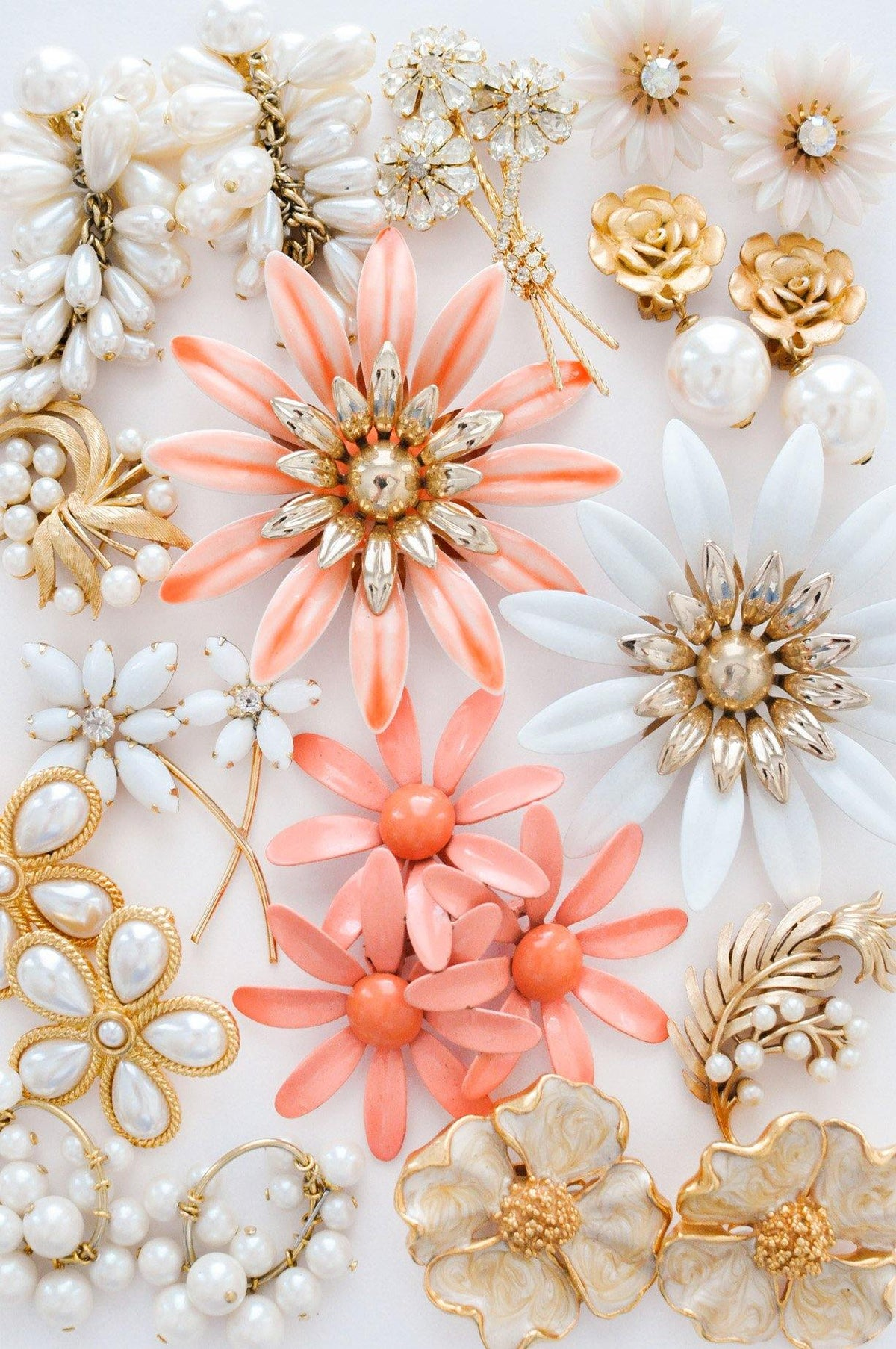 Vintage brooches and earrings from Sweet & Spark.