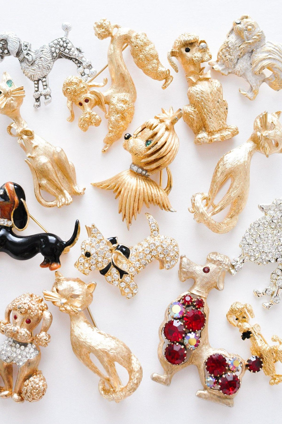 Vintage dog and cat animal brooches from Sweet & Spark.