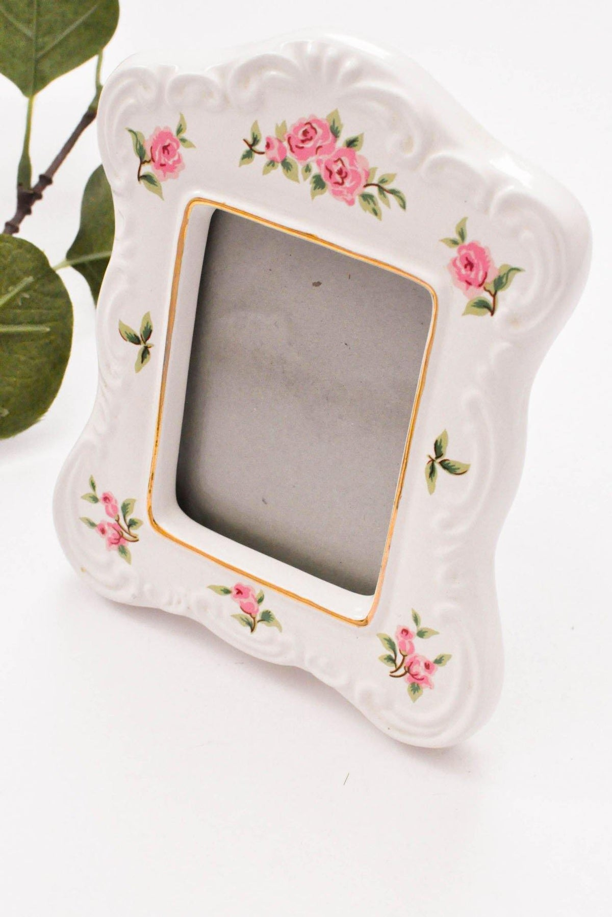Floral painted photo frame from Sweet & Spark.