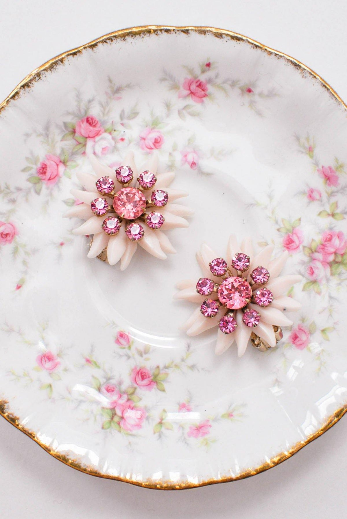 Pink floral clip-on earrings.