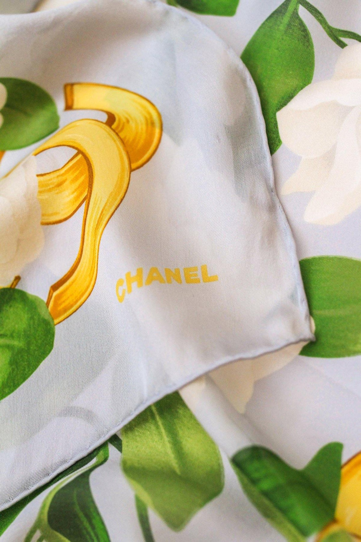 Vintage Chanel Light Blue Camellia Scarf from  Sweet & Spark.