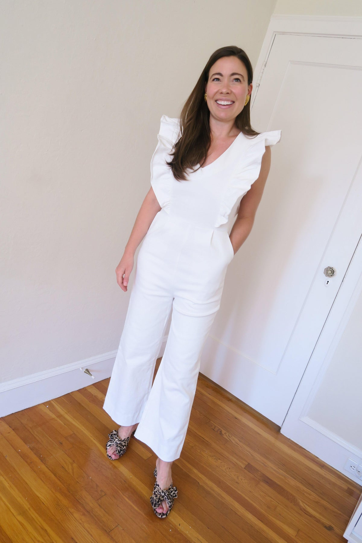 En Saison white denim ruffled jumpsuit.