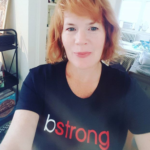 Red-haired woman wearing a bstrong shirt for Bethenny Frankel's charity