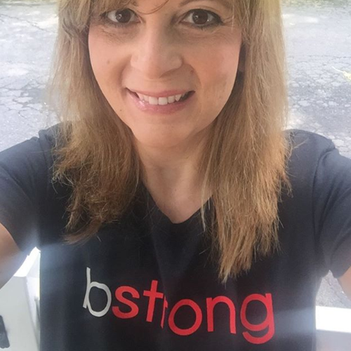 Happy woman wearing a bstrong shirt for Bethenny Frankel's bstrong charity