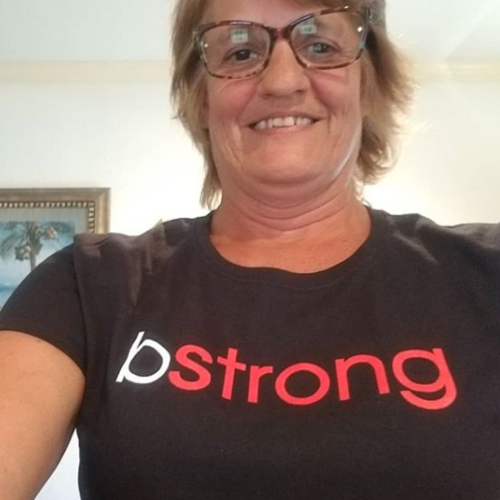 Smiling woman wearing a bstrong shirt for Bethenny Frankel's charity
