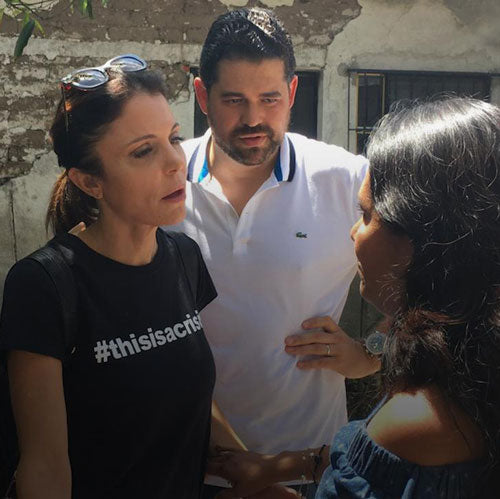 Bethenny Frankel talking with disaster victims and wearing a #thisiscrisis shirt