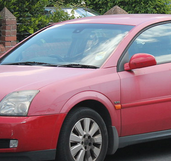 Oxidized red paint on a car