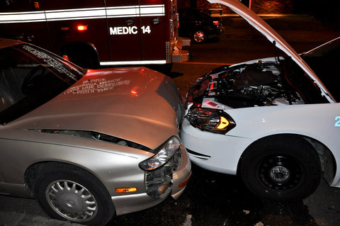 car collision with damaged bumpers
