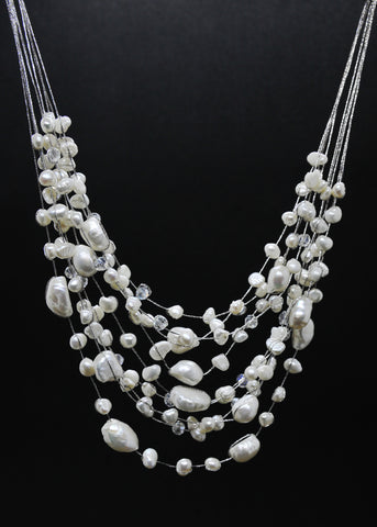 Multi-sized oval white pearl 7 strand necklace