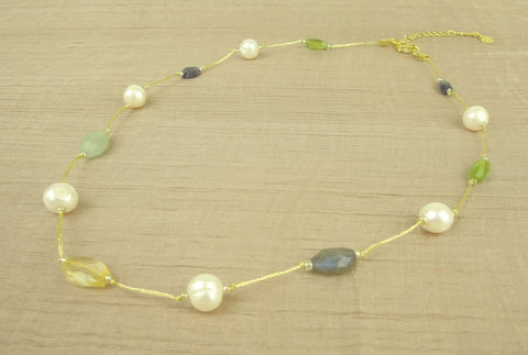 Necklace w white + green pearl + stone on gold silk thread