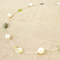 Necklace w white pearl + stone on silver silk thread