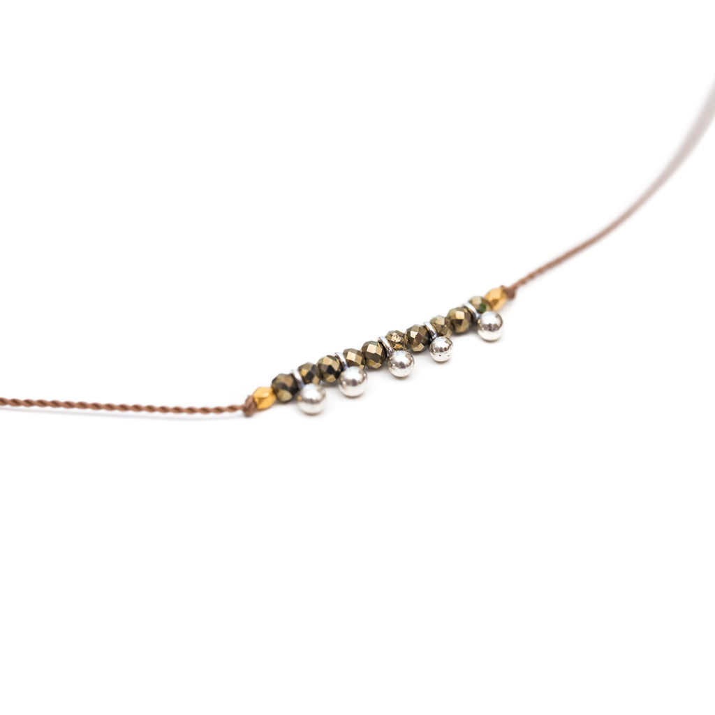Our Cairn necklaces are durable, stylish and functional, a Bronwen Jewelry favorite for everyday active-chic