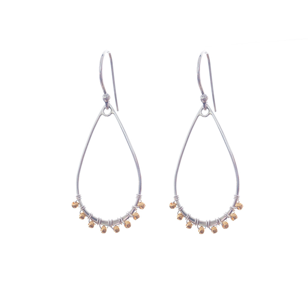 Origin earrings are a Bronwen Jewelry must have. Sterling silver or gold, these are everyday active-chic