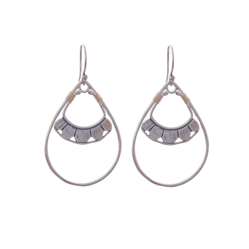 Our Pionera earrings come in silver and gold, a Bronwen Jewelry pick for travel and adventure