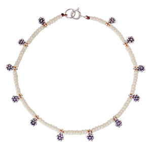 Our Thai Daisy beaded bracelet is dainty and durable, a Bronwen Jewelry favorite. Beautiful jewelry for an active lifestyle.
