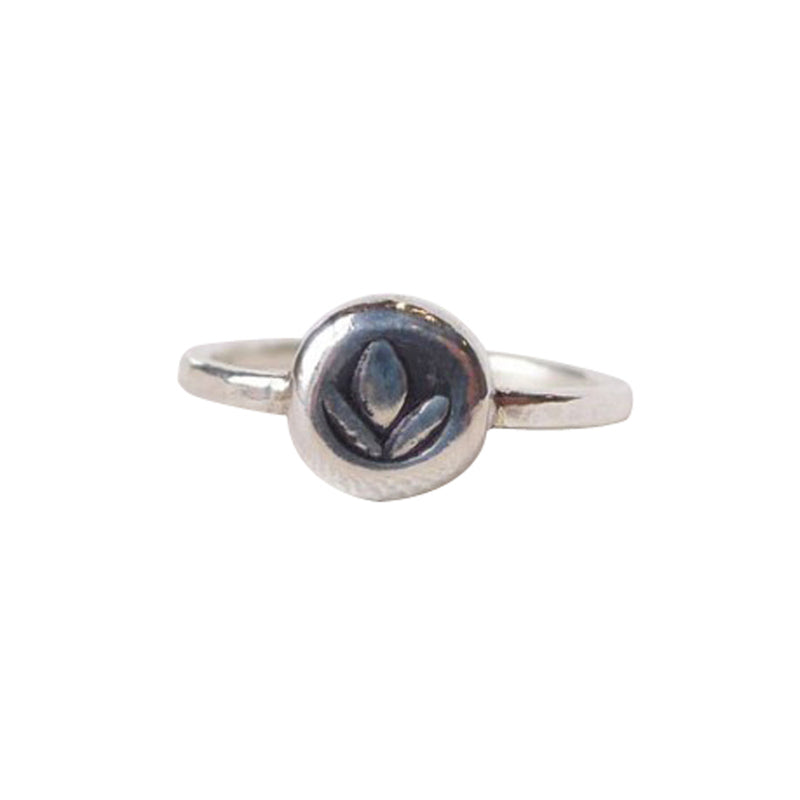 Our Tiny Charm Lotus ring is lightweight and strong, a Bronwen Jewelry staple for your active lifestyle