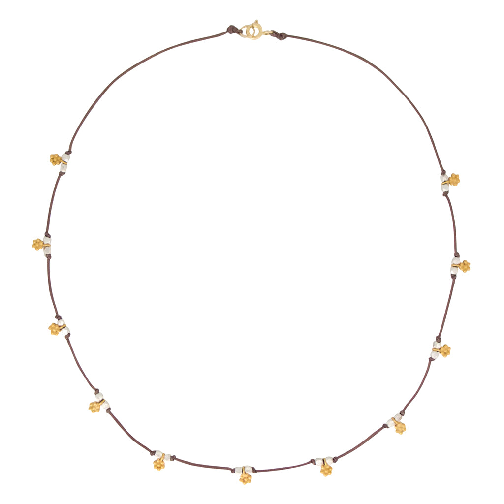 Our Daisy Chain necklace is water worthy, durable and a mixed metal Bronwen Jewelry favorite for your active lifestyle