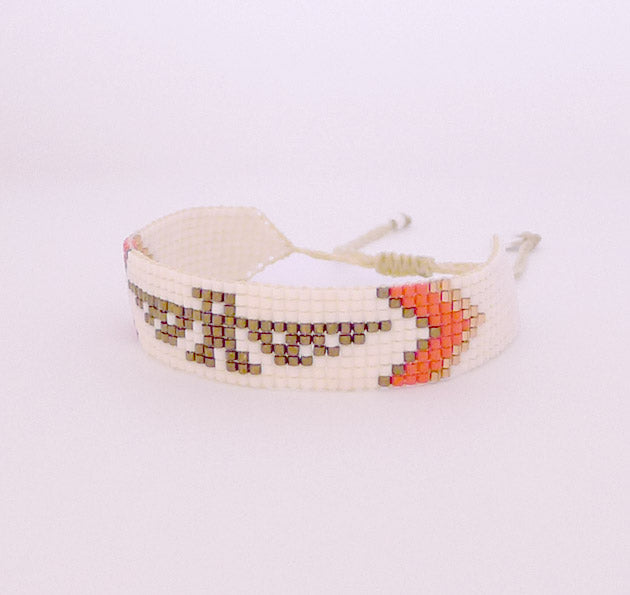 Our Thunderbird Beaded Cuff is a Bronwen Jewelry statement piece. Elegant, adjustable and artisan made in Columbia
