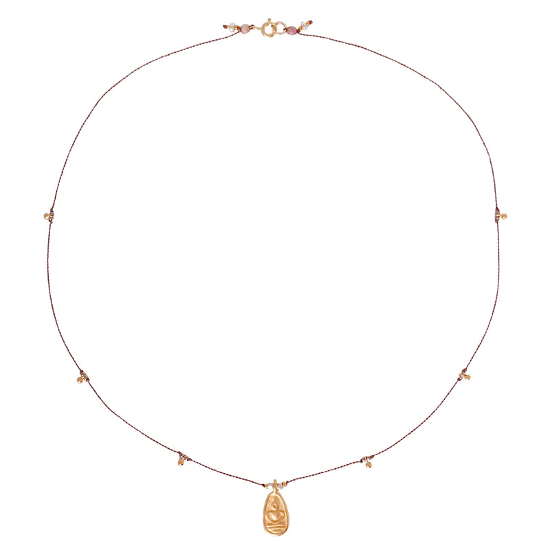 Seated Buddha necklace by Bronwen Jewelry can run, swim or do yoga with you, all while adding elegance to your look
