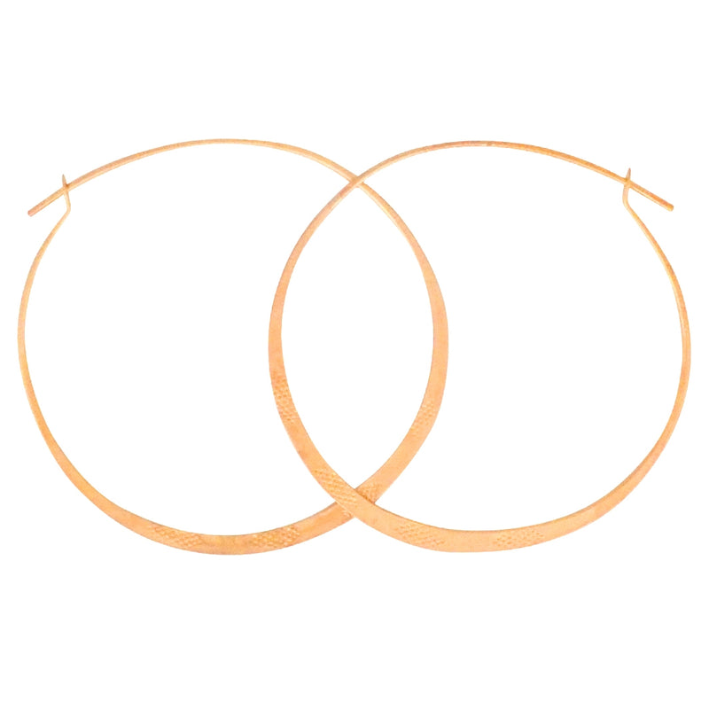Standard Issue Hoop earrings are a Bronwen Jewelry bestseller. Handstamped, in silver or gold, they are everyday active-chic