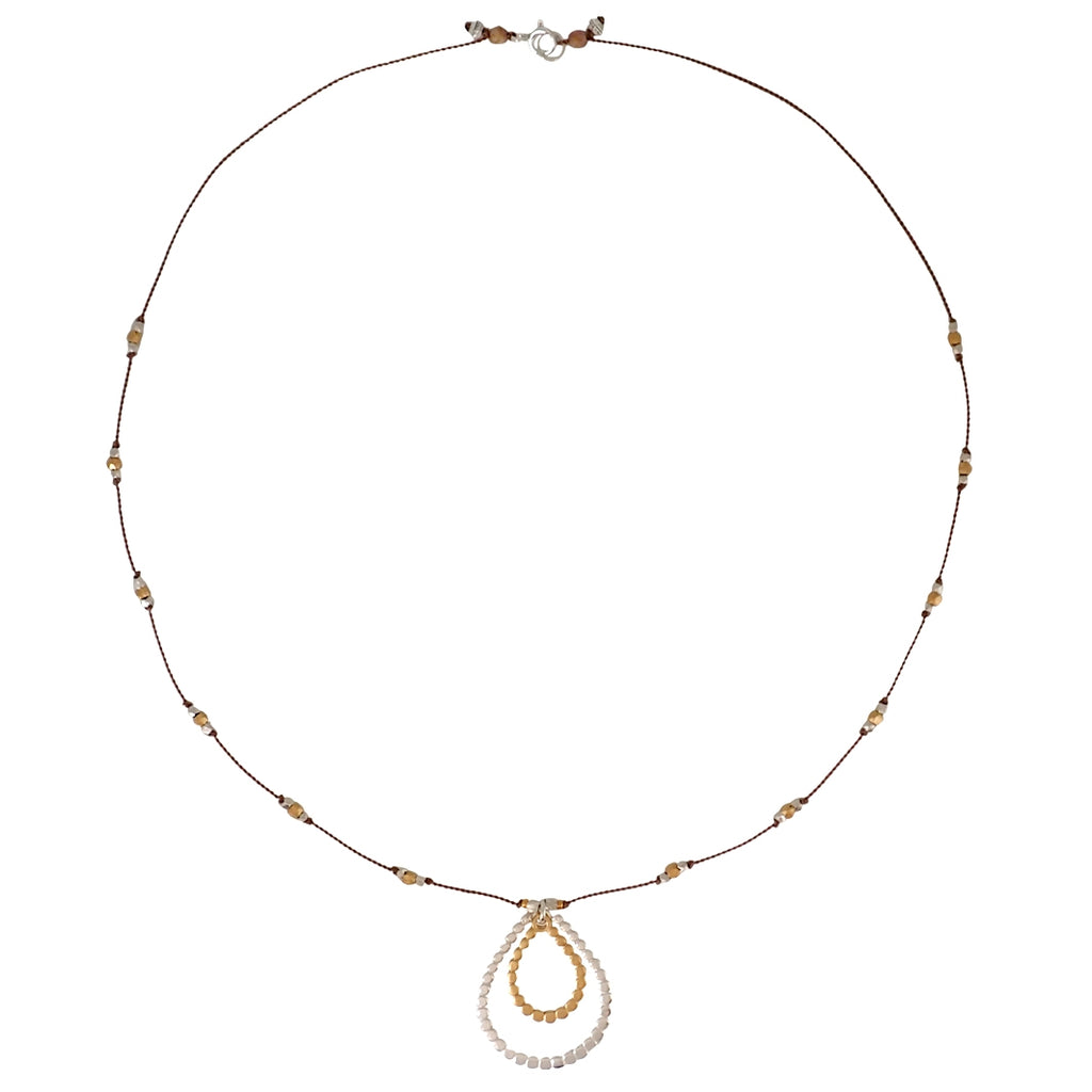 Sun Disc necklace by Bronwen Jewelry can run, swim or do yoga with you, all while adding elegance to your everyday look