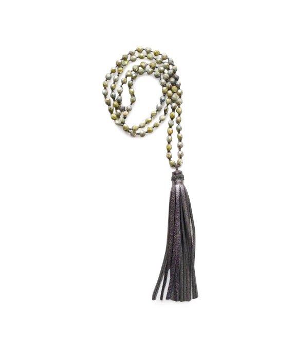 Calypso Tassle necklaces are handmade with glass beads and a pretty suede tassle, a Bronwen Jewelry active-chic favorite