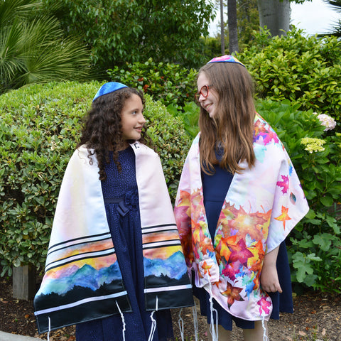 Alma and Eva modeling Mountain Tallit and Fall Leaves Tallit by Anna Abramzon