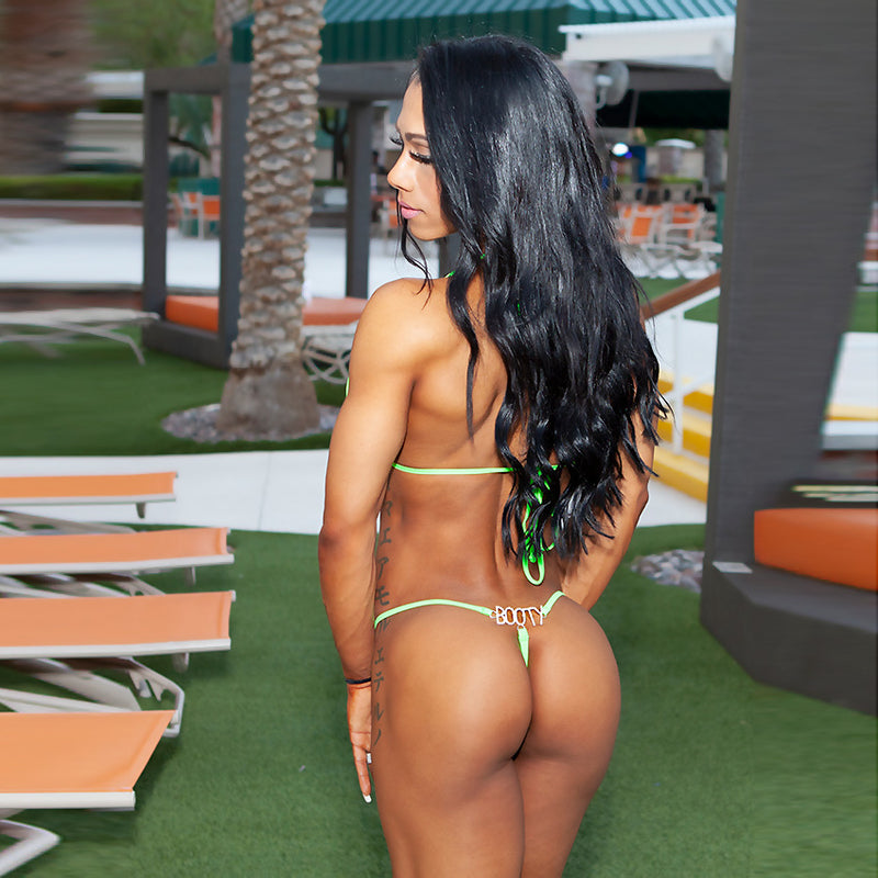 G-string bikini with BOOTY jewel back, model Marcia Goncalves.