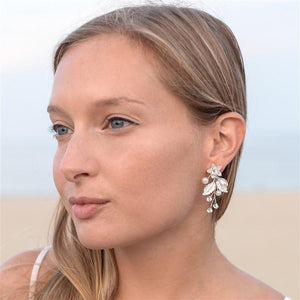 Matte Silver Leaves and Ivory Pearls Jeweled Earrings with Crystal Gems by the ring madam