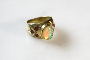 Gold Signet Ring with opal center stone and 6 orange sapphires