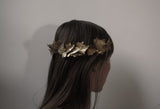 brass ivy crown, on a model, viewed from the side