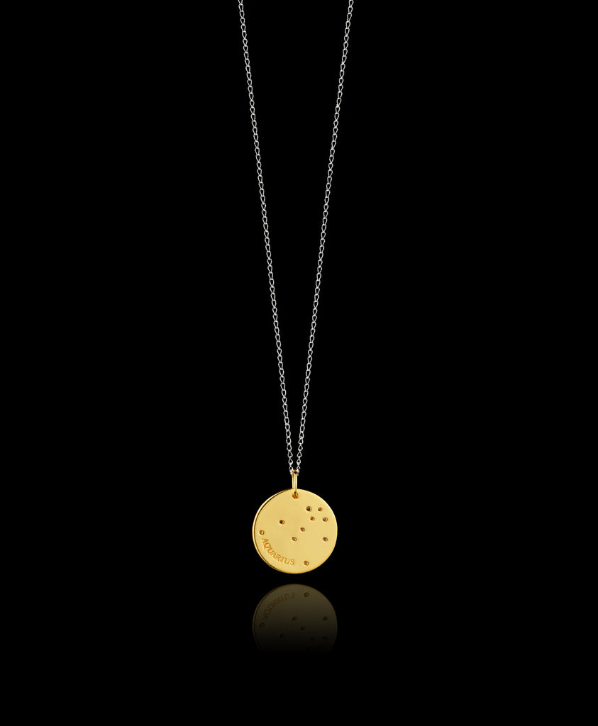 Full length Aquarius Zodiac star sign pendant in gold with silver chain. Made by British jewellery designer Catherine Zoraida