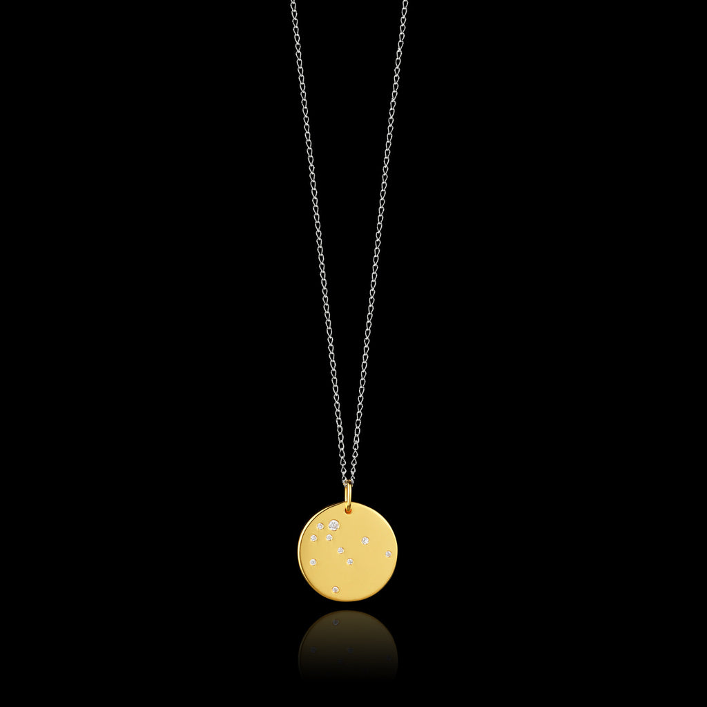 Aquarius Zodiac star sign pendant in gold with silver chain. Made by British jewellery designer Catherine Zoraida