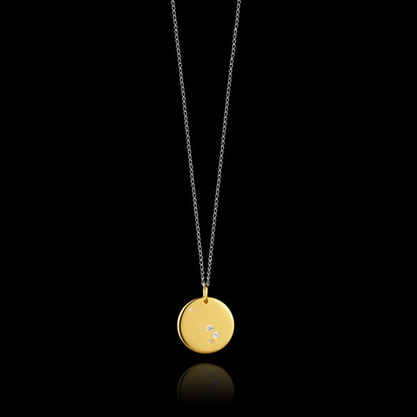 Aries Zodiac star sign pendant in gold with silver chain. Made by British jewellery designer Catherine Zoraida