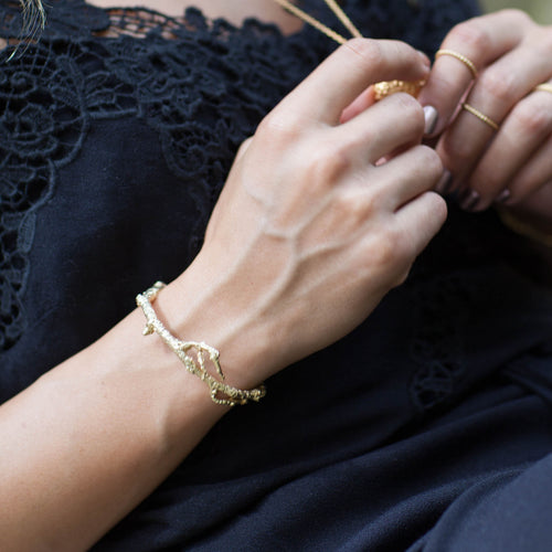 Gold Catherine Zoraida Apple Twig and Diamond Bracelet modelled by Rocky Barnes
