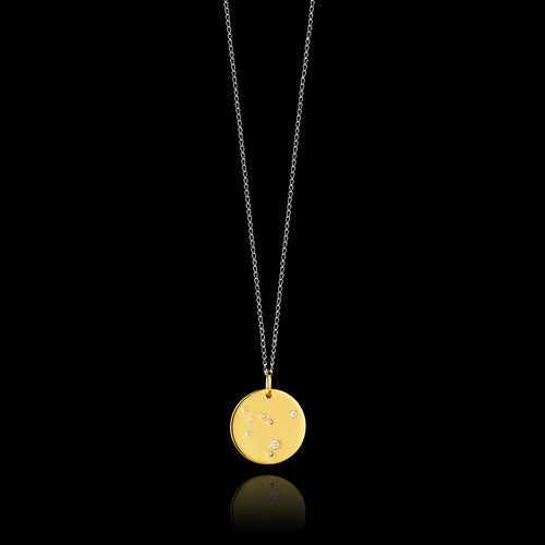 Capricorn Zodiac star sign pendant in gold with silver chain. Made by British jewellery designer Catherine Zoraida