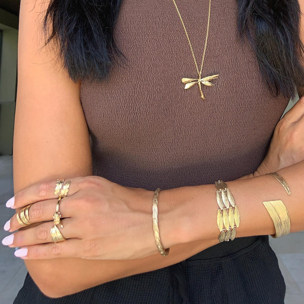Talia Richman wears Catherine Zoraida Gold Spread Your Wings Bracelet