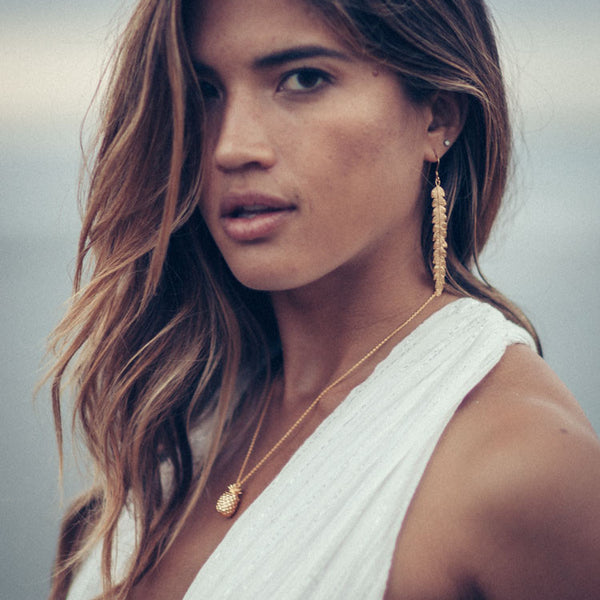 Rocky Barnes wears Catherine Zoraida Gold Long Fern Earrings