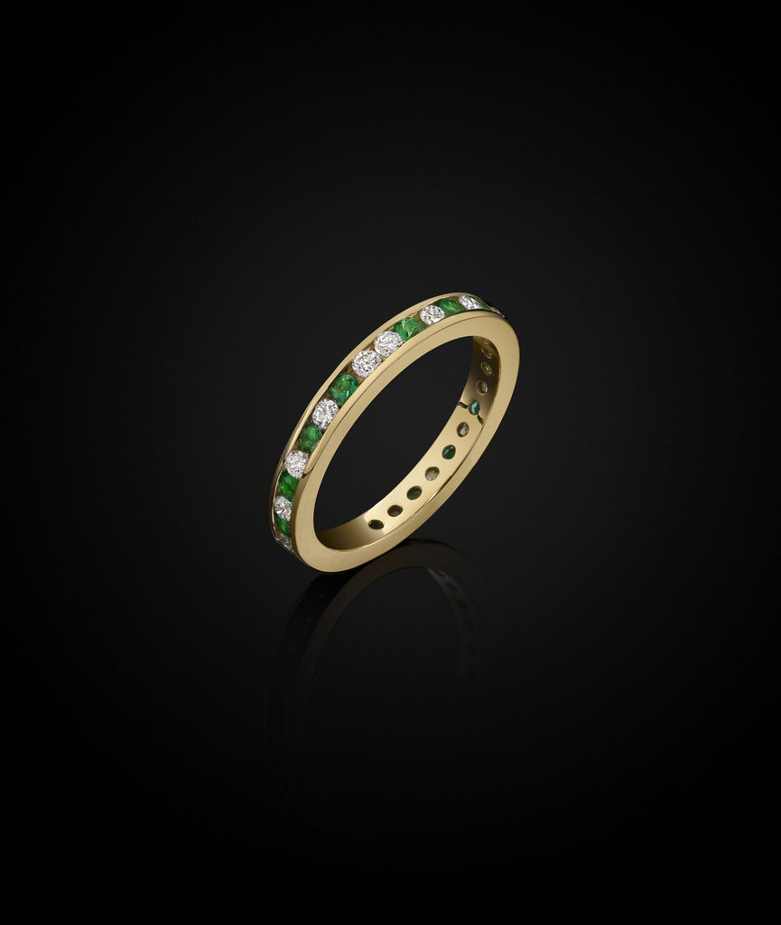 18ct gold eternity ring with emeralds and diamonds. Designed by British Jeweller Catherine Zoraida