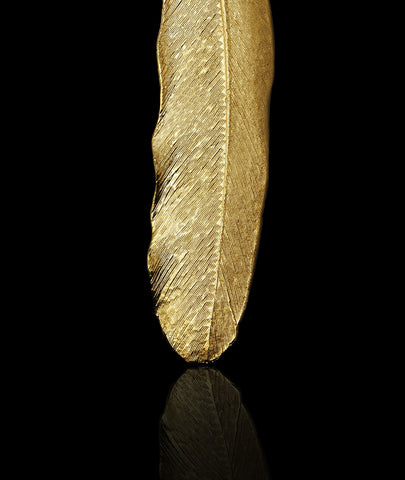 Close up of Gold plated buzzard feather Pendant / necklace by British jewellery designer Catherine Zoraida