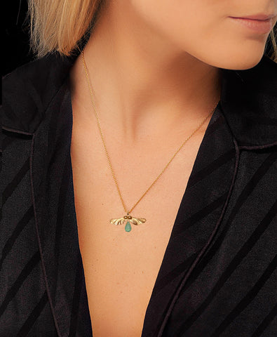 Gold and Aventurine Pendant Necklace by Catherine Zoraida. Modelled by Lucy Williams