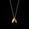 Gold Double Leaf Pendant by Catherine zoraida